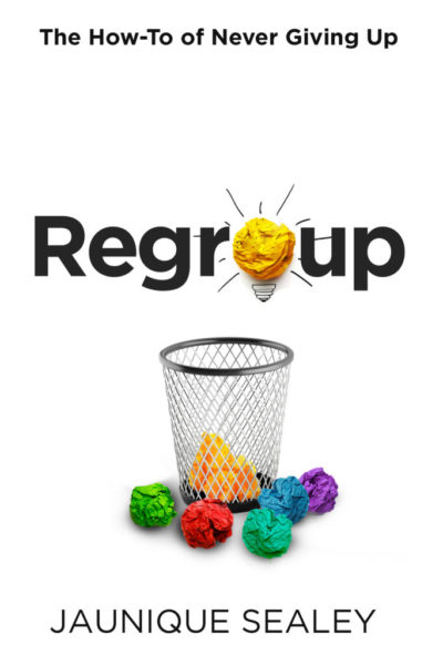 The clean and beautiful book cover of Regroup: the How-To of Never Giving Up shows brightly colored paper balls surrounding a metal mesh wastebasket. It depicts a bright idea as a vibrant yellow paper ball that also serves as the letter